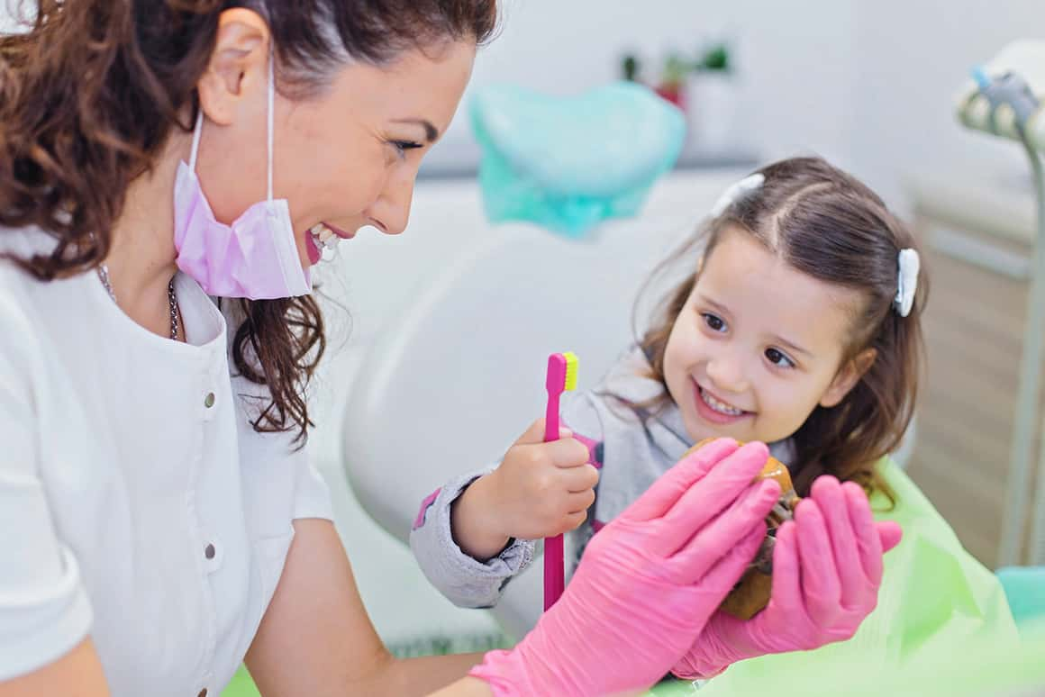 dentist with little girl patient