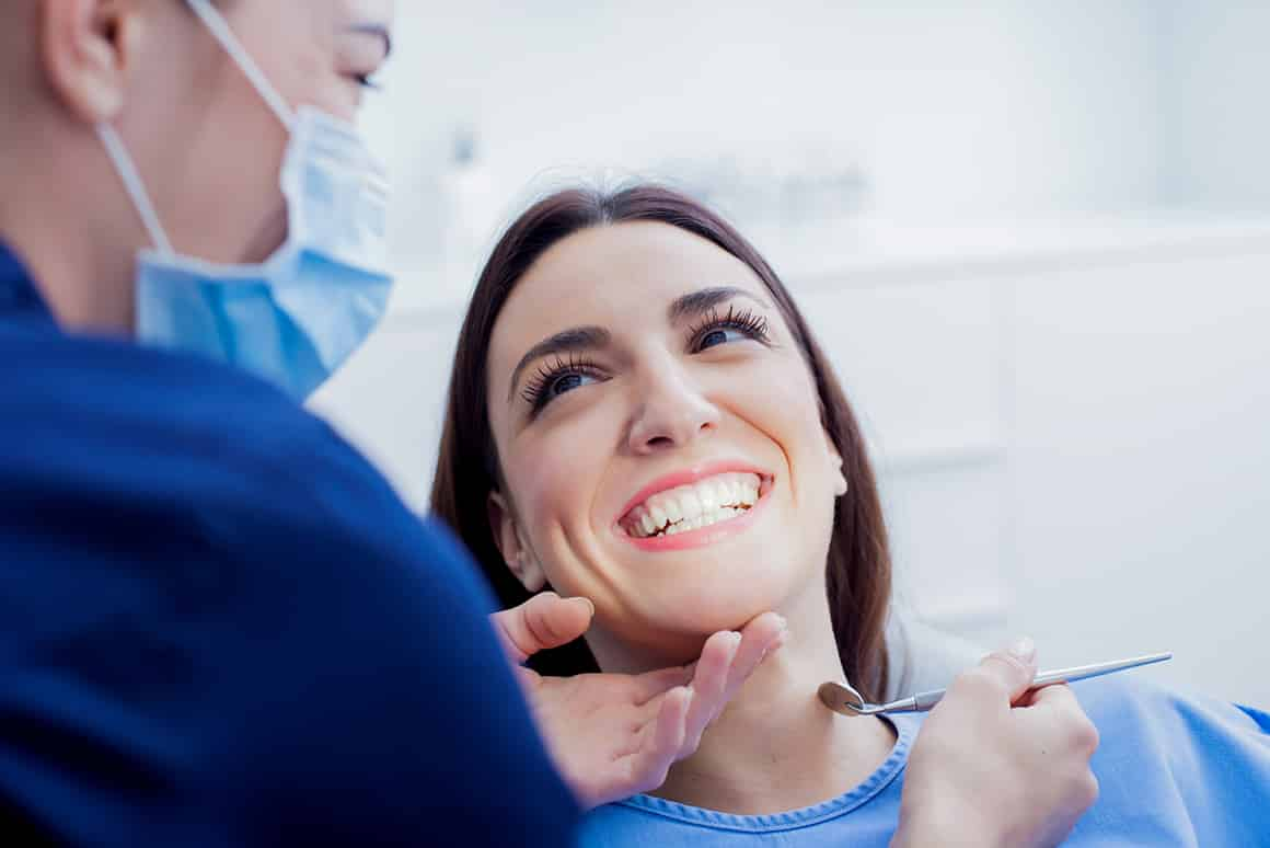 woman smiling in the dentist chair