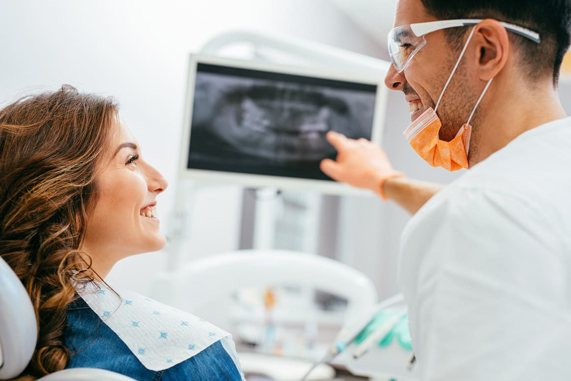 dentist showing patient her xrays