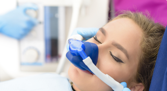 girl undergoing sedation at the dentist office