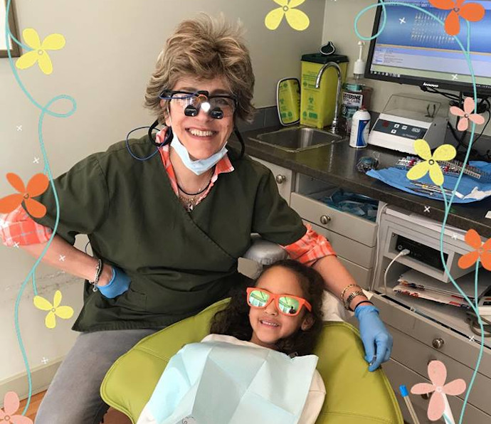 Dr. Kate Mahallati with a young patient