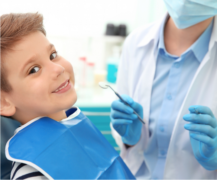 boy smiling at dentist office